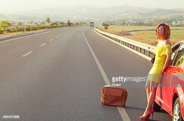 girl, stukced on the highway - short skirts in cars stock photos and pictures
