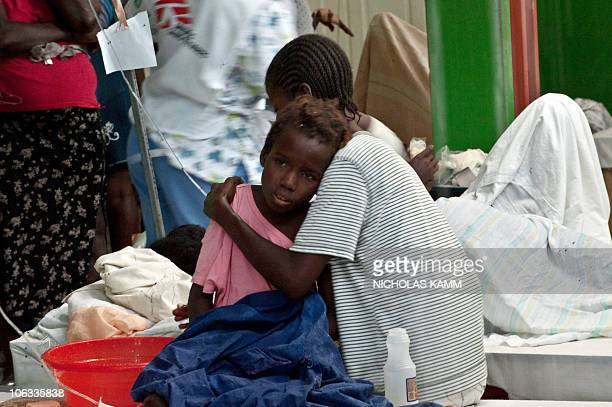 A girl suffering from cholera rests on her mother's shoulder at the Charles Colimon hospital in Petite Riviere on the Artibonite river believed to be...
