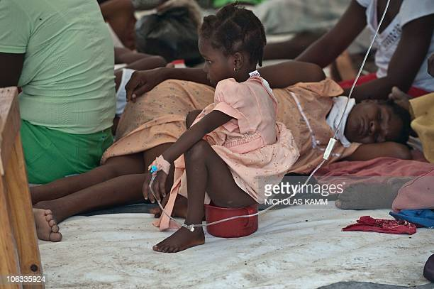 A girl suffering from cholera sits on a pot at the Charles Colimon hospital in Petite Riviere on the Artibonite river believed to be the source of...