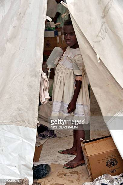 A girl suffering from cholera stands in a tent at the Charles Colimon hospital in Petite Riviere on the Artibonite river believed to be the source of...