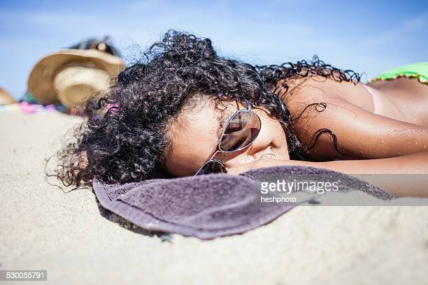 girl sunbathing on beach, truro, massachusetts, cape cod, usa - heshphoto - fotografias e filmes do acervo