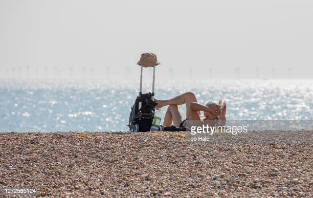 Girl sunbathing on the beach on September 14, 2020 in Hove, England. The UK was expected to hit 29 degrees celsius as the country imposed new rules...