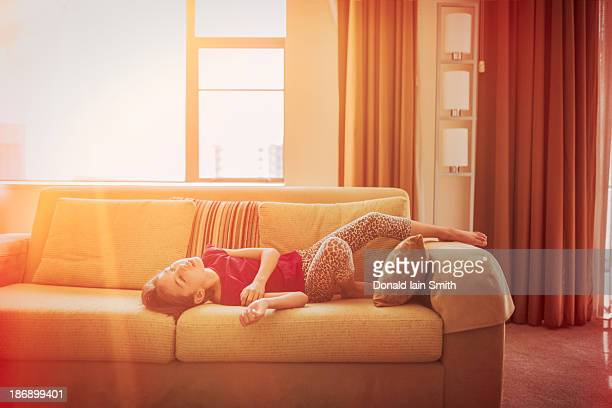 Girl, sunlight and sofa