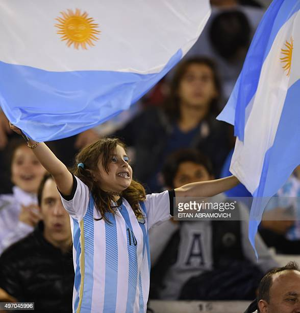 A girl supporter of Argentina waits for the start of the Russia 2018 FIFA World Cup South American Qualifiers football match between Argentina and...