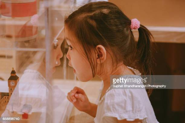 Girl surprising at display box