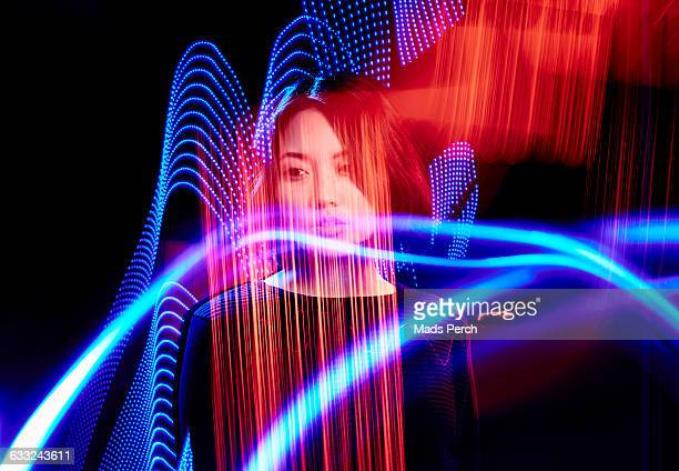 Girl  surrounded by colorful lights