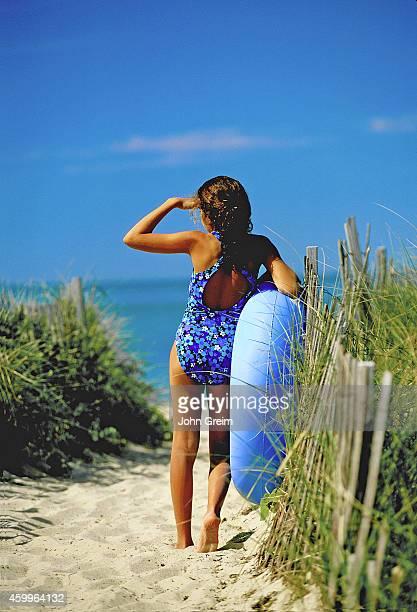 Girl surveys the beach in anticipation