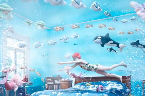 Girl swimming in her bedroom - gettyimageskorea