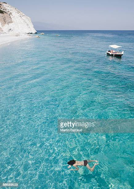 Girl swimming in ocean near beach, Lalaria Beach, Skiathos, Greece