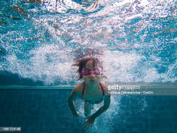 girl swimming in pool - swimming stock pictures, royalty-free photos & images