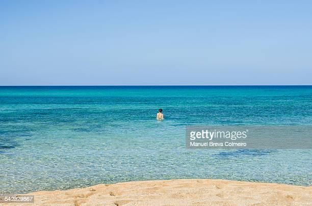 A girl swimming in the sea