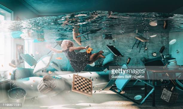 girl swimming in water - people stock pictures, royalty-free photos & images