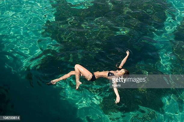 girl swimming - petite young models stock photos and pictures