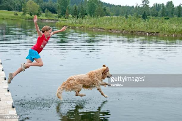 Girl Swimming With Her Dog