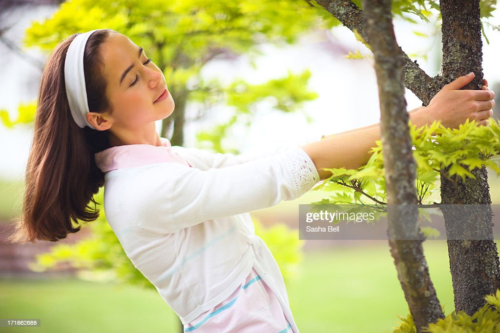 Girl swinging from acer tree : Stock Photo