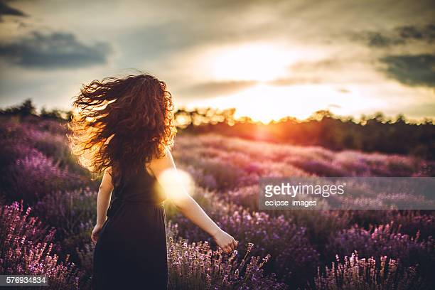 Girl swinging hair in lavender field