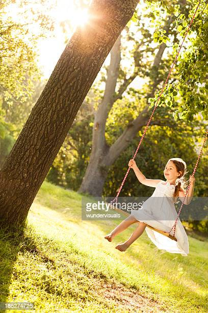 Girl Swinging In Park