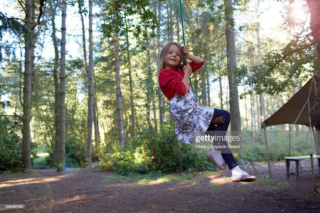 Girl swinging on a tree : Stock Photo