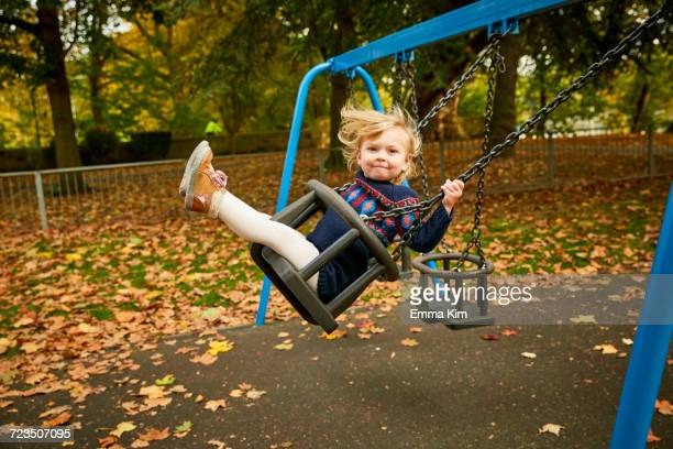 Girl swinging on playground swing