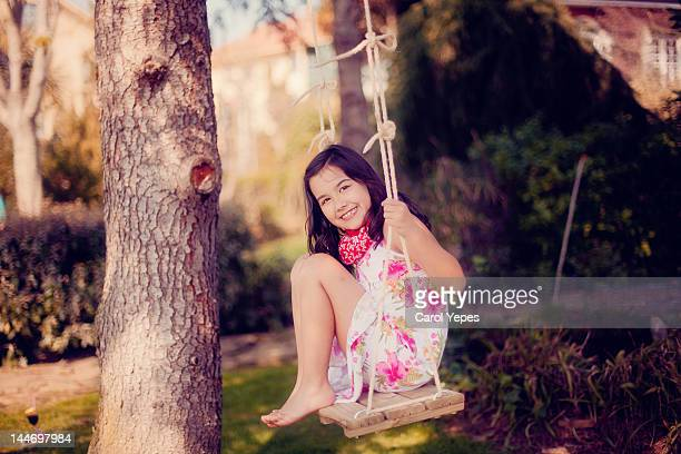 Girl swinging on swing