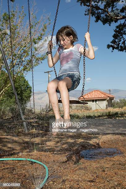 girl swinging - wet t shirt girls stock photos and pictures