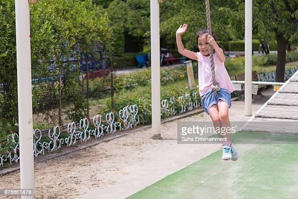 girl swings her arms as flying fox - saha entertainment stock pictures, royalty-free photos & images