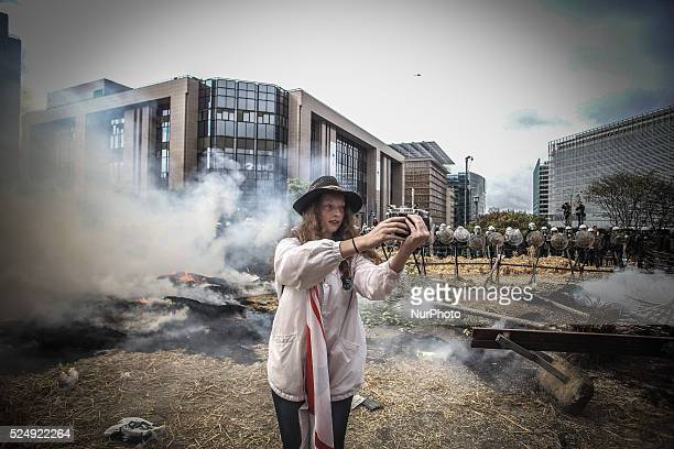 A girl take a quotselfiequot during a demonstration of farmers in front of the European Commission building on September 7 in Brussels as European...