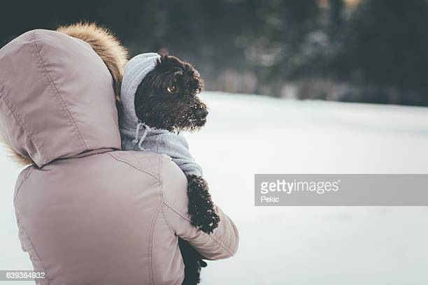 Girl take care of her frozen dog