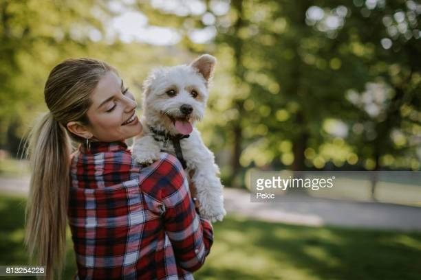 Girl take care of puppy