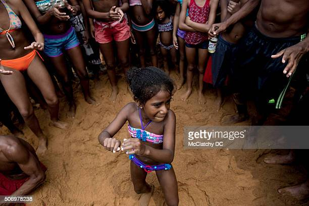Girl takes her turn in the tambor circle -- a group dance popular on Venezuela's beaches -- on Oct. 11 at Playa Colorada on Venezuela's north coast.