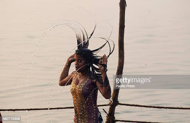 A girl takes holy bath in the Sangam confluence of three rivers the Ganga the Yamuna and mythical Saraswati on the occasion of Maghi Purnima festival...