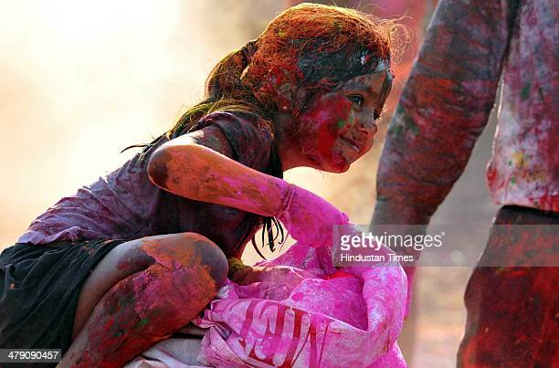 A girl takes out dry colour from bag to flunk it on her friends at Sakar city situated at Bypass on March 16 2014 in Indore India The festival falls...