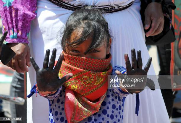 Girl takes part in a demonstration against violence against women during a march on International Women's Day, in Mexico City on March 8, 2020. -...