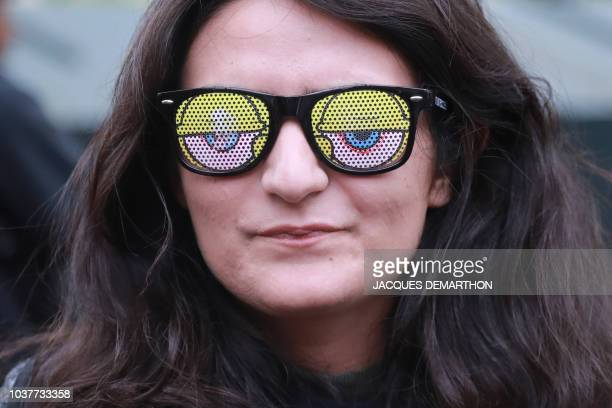 A girl takes part in the 20th annual Techno Parade in Paris on September 22 2018