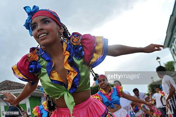 A girl takes part in the Burial of arrogance and haughtiness carnival during the IX Poetry Festival in Granada 45 km from Managua Nicaragua on...