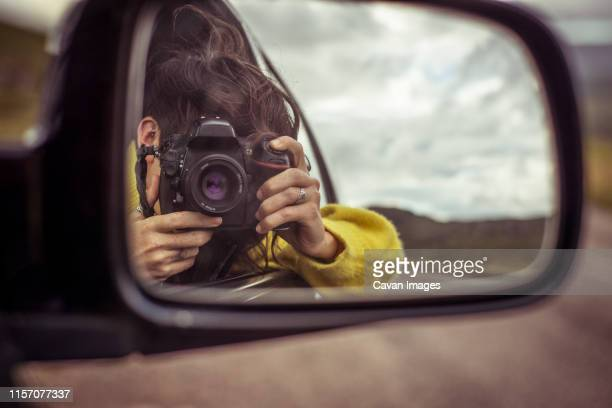 girl takes photo in car mirror - ferry stock pictures, royalty-free photos & images