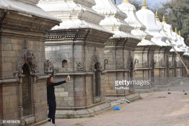A Girl takes pictures from her mobile phone at the premises of Pashupatinath Temple Kathmandu Nepal on Tuesday February 06 2018