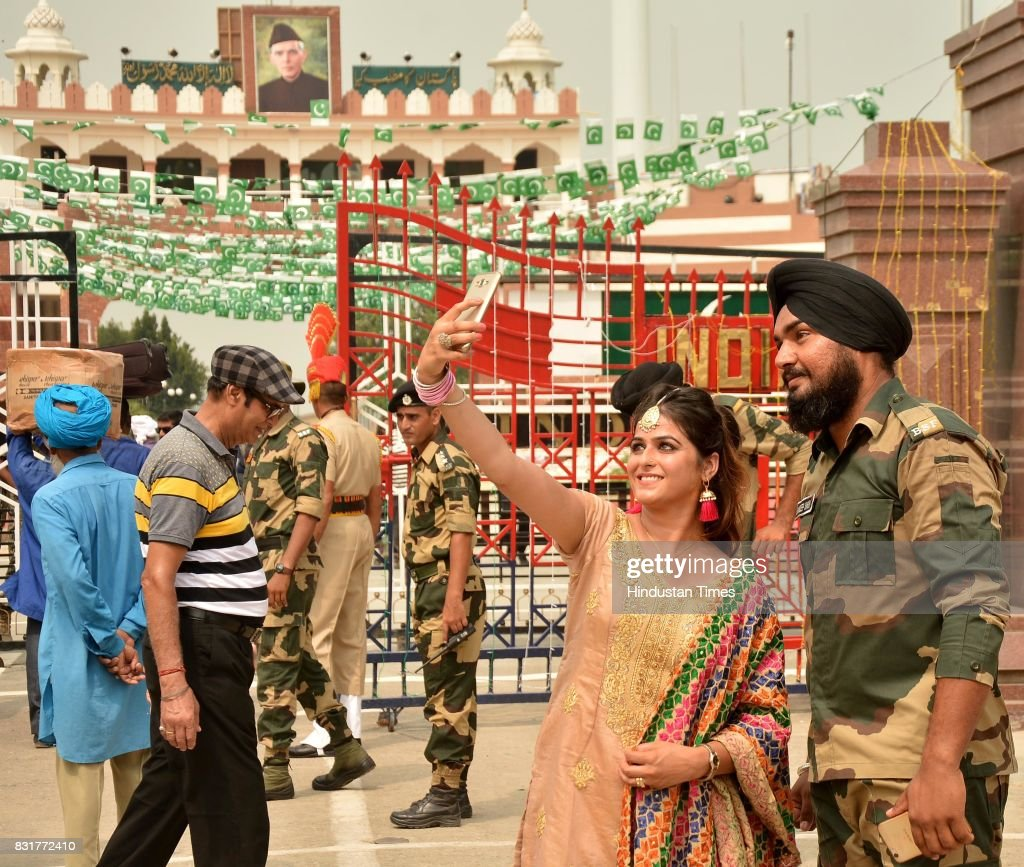 A girl takes selfie with Indian Border Security Force soldier on the occasion of the India's 71st Independence Day at the IndiaPakistan Wagah Bord