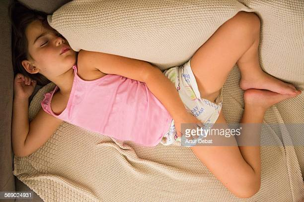 girl taking a nap at the sofa from overhead view. - hot young girls stock photos and pictures