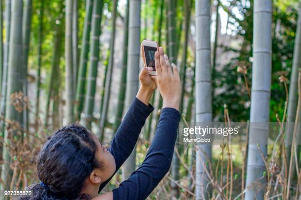 Girl taking a picture on her phone camera