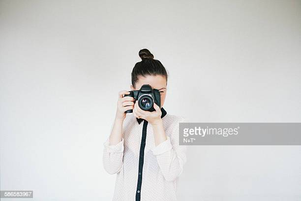 girl taking a picture - n n girl model stock photos and pictures