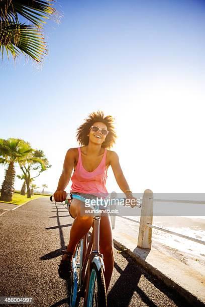 Girl taking a seaside ride with bike