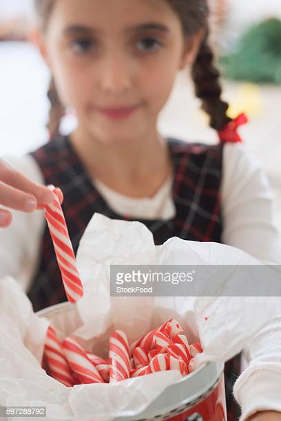 girl taking candy stick from jar - candy samples stock pictures, royalty-free photos & images