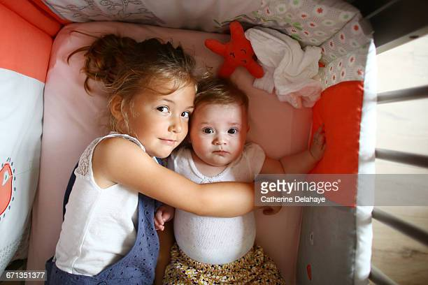 A girl taking care of her baby sister