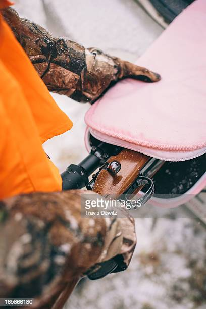 Girl taking deer hunting rifle out of her pink gun case for the Wisconsin Whitetail deer hunting season.