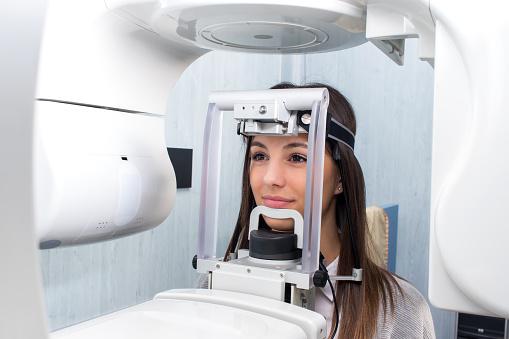 Girl taking digital 3D panoramic dental x-ray. 648724626