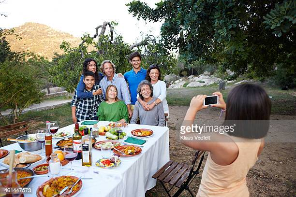 girl taking photo of her family with smartphone - klaus vedfelt mallorca stock pictures, royalty-free photos & images