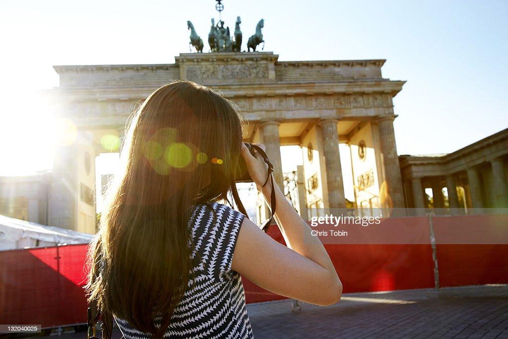Girl taking photo of monument : Stock Photo