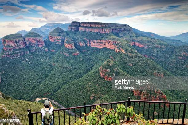 girl taking photo of three rondavels at blyde river canyon - mpumalanga province stock pictures, royalty-free photos & images