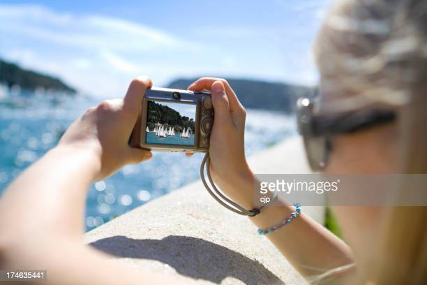 Girl Taking Photo of Yachts